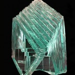 "Laminated and carved glass sculpture 18""H"