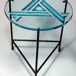 Carved and painted glass end table.