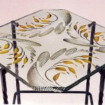 Carved and painted glass table.