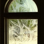 Custom carved and glue chipped window.