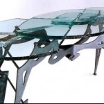Carved and laminated glass table top.