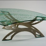 Custom glass top coffee table carved and painted. Powder coated steel base.