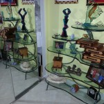 Carved and painted glass. Patina bronze shelves by Rhonda Kap