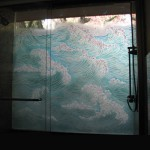 Shower Wall carved, tempered and painted glass wall. Dual glazed.