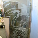 Custom carved and tempered shower door.