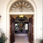 Leaded front door and transom window.