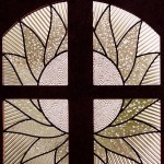 Leaded glass insert in door.
