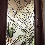 Beveled leaded glass doors.