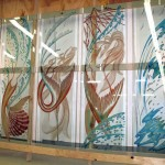 Carved, tempered and painted glass doors.