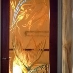 Custom carved, tempered and painted glass doors.