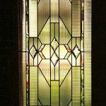 Beveled and leaded glass door.