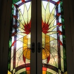 Stained glass front doors.