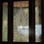 Leaded glass door with side lights.